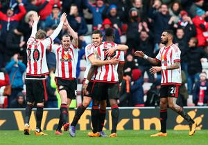 SUNDERLAND, ENGLAND - FEBRUARY 13: (L to R) Ola Toivonen, John O'Shea, Jack Rodwell, Lamine Kone and Yann M'Vila of Sunderland celebrate their 2-1 win in the Barclays Premier League match between Sunderland and Manchester United at the Stadium of Light on February 13, 2016 in Sunderland, England.  (Photo by Clive Brunskill/Getty Images)