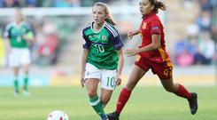 Attack: Northern Ireland's Megan Reilly breaks away from Spain's Paula Fenandez Himanez