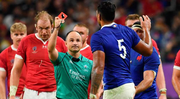 Referee Jaco Peyper shows a red card to Frances's Sebastien Vahaamahina