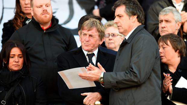 Former Liverpool player and manager Kenny Dalglish (C), stands amongst dignitaries and relatives of the victims of the 1989 Hillsborough disaster, after reading a poem on the steps of St George's Hall in Liverpool, north west England on April 27, 2016, in remembrance of the Liverpool fans who died in the Hillsborough football stadium disaster. Thousands of sympathisers paid an emotional tribute to the Hillsborough disaster victims today after a landmark inquest found that 96 Liverpool football fans were unlawfully killed. / AFP PHOTO / PAUL ELLISPAUL ELLIS/AFP/Getty Images
