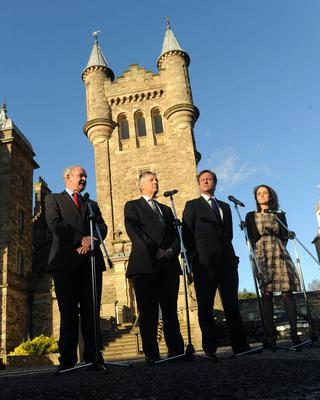 PACEMAKER BELFAST  20/11/2012  Prime Minister David Cameron  meets First Minister Peter Robinson , Deputy First Minister Martin McGuinness and Secretary of State for Northern Ireland Theresa Villiers  at Stormont Castle  in Belfast during his visit to Northern Ireland , During his visit  The Prime minister announced that The main venue for the annual  G8 event is to be  at Lough Erne golf resort near Enniskillen, County Fermanagh  next year  Photo Colm Lenaghan/ Pacemaker Press