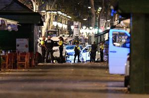 BARCELONA, SPAIN - AUGUST 17:  A damaged van, believed to be the one used in the attack, is surrounded by police officers in the Las Ramblas area on August 17, 2017 in Barcelona, Spain. Officials say 13 people are confirmed dead and at least 50 injured after a van plowed into people in the Las Ramblas area of the city this afternoon. (Photo by David Ramos/Getty Images) ***BESTPIX***