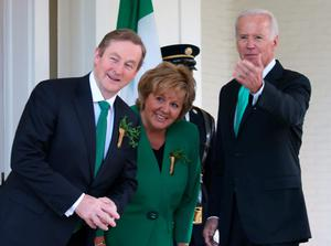 US Vice President Joseph Biden welcomes Prime Minister Enda Kenny of Ireland and his wife Fionnuala Kenny to the Naval Observatory on March 17, 2015 in Washington, DC. Vice President Biden hosted a breakfast for the Irish Prime Minister in honor of St. Patrick's Day. (Photo by Mark Wilson/Getty Images)