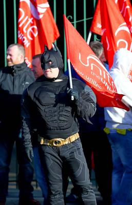 Kevin Scott / Belfast Telegraph   Friday 13th March 2015 - Public Sector Strikes  Pictured Batman of the UNITE union on strike outside the Falls Road Bus Depot in West Belfast on Friday 13th March.    Picture - Kevin Scott / Belfast Telegraph