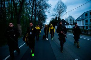 DORTMUND, GERMANY - APRIL 11: Police escort the players near after the team bus of the Borussia Dortmund football club was damaged in an explosion on April 11, 2017 in Dortmund, Germany. According to police an explosion detonated as the bus was leaving the hotel where the team was staying to bring them to their Champions League game against Monaco. So far one person, team member Marc Bartra, is reported injured.   (Photo by Maja Hitij/Getty Images)