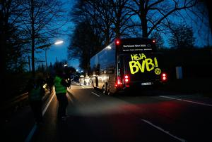 DORTMUND, GERMANY - APRIL 11: The team bus of the Borussia Dortmund football club seen after the bus was damaged in an explosion on April 11, 2017 in Dortmund, Germany. According to police an explosion detonated as the bus was leaving the hotel where the team was staying to bring them to their Champions League game against Monaco. So far one person, team member Marc Bartra, is reported injured.  (Photo by Maja Hitij/Getty Images)