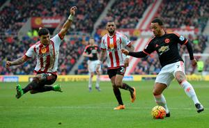 Sunderland's US defender DeAndre Yedlin (L) jumps to block a cross from Manchester United's Dutch midfielder Memphis Depay (R) during the English Premier League football match between Sunderland and Manchester United at the Stadium of Light in Sunderland, northeast England on February 13, 2016. /  / OLI SCARFF/AFP/Getty Images