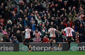 Sunderland's French-born Ivorian defender Lamine Koné (L) celebrates after heading the ball to score his team's second goal during the English Premier League football match between Sunderland and Manchester United at the Stadium of Light in Sunderland, northeast England on February 13, 2016.  Sunderland won the match 2-1.   / OLI SCARFF/AFP/Getty Images