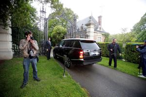 One of the cars of Kim Kardashian, Kanye West and their guests arrives at the entrance of the Wideville Castle, in Davron, 35 miles west of Paris, Friday, May 23, 2014. The gates of the Chateau de Versailles, once the digs of Louis XIV, will be thrown open to Kim Kardashian, Kanye West and their guests for a private evening on the eve of their marriage.(AP Photo/Francois Mori)