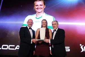 Local Heroes award winner: Aisling Reilly is presented with her trophy by GAA Tyrone Manager Mickey Harte and Brian Henning, Chair of Sport Northern Ireland. Picture by Kelvin Boyes/ Press Eye
