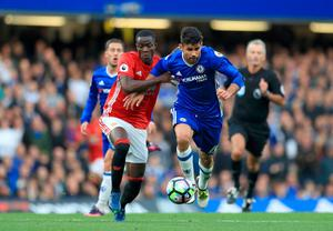 "Manchester United's Eric Bailly (left) and Chelsea's Diego Costa battle for the ball during the Premier League match at Stamford Bridge, London. PRESS ASSOCIATION Photo. Picture date: Sunday October 23, 2016. See PA story SOCCER Chelsea. Photo credit should read: John Walton/PA Wire. RESTRICTIONS: EDITORIAL USE ONLY No use with unauthorised audio, video, data, fixture lists, club/league logos or ""live"" services. Online in-match use limited to 75 images, no video emulation. No use in betting, games or single club/league/player publications."