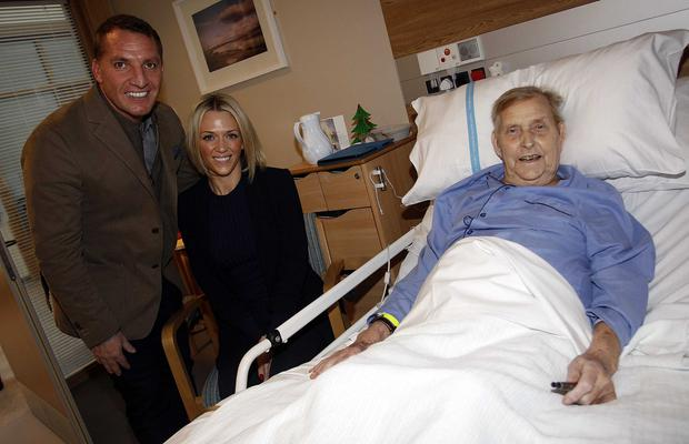 Celtic manager Brendan Rodgers and  Charlotte Searle  with patient Hubert Cowan at the Northern Ireland Hospice on Christmas morning