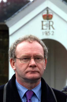 File photo dated 18/01/01 of Martin McGuinness of Sinn Fein standing beside a sentry box outside Hillsborough Castle before a meeting with Prime Minister Tony Blair. PA