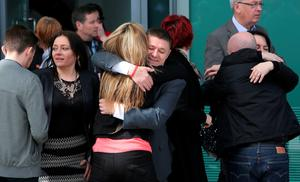 Relatives of the victims of the 1989 Hillsborough disaster react following the conclusion of the inquest into the disaster, at the coroner's court in Warrington, north-west England on April 26, 2016. Pic: Getty