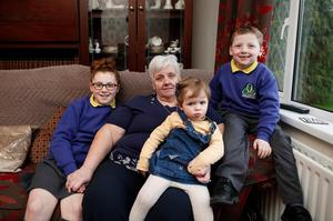 Close bond: Geraldine with her grandchildren (from left) Lora Cassidy, Molly Campbell and Josh Cassidy