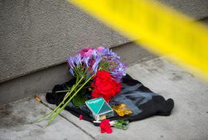 Flowers and a cigarette box form a makeshift shrine near the area where a fourth floor balcony collapsed in Berkeley (AP Photo/Noah Berger)