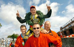 Michael on his dad's shoulders flanked by brother William and mechanic Ronnie Shiels after winning the Manx Grand Prix Newcomers race in 2006