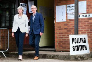 Prime Minister Theresa May and her husband Philip leave after casting their votes in the General Election at a polling station in the village of Sonning. Pic: Stefan Rousseau/PA Wire