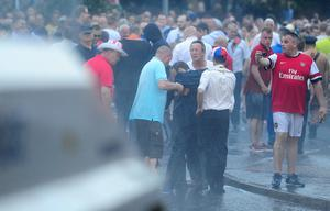 North Belfast MP Nigel Dodds was injured in violence that followed an Orange Order parade. Police say Mr Dodds was knocked unconscious and taken away in an ambulance. Earlier he had appealed for calm after trouble broke out when the Orange parade was stopped on the Woodvale Road and was hit with a water cannon. Picture: Arthur Allison/Pacemaker Press