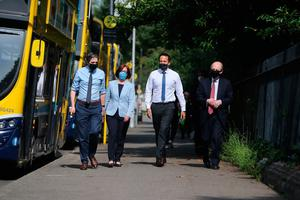 (left to right) Health Minister Simon Harris, Anne Graham CEO of the National Transport Authority, Taoiseach Leo Varadkar and Transport Minister Shane Ross in Dublin city centre encouraging passengers to wear face masks on public transport in Ireland as coronavirus lockdown measures are eased. PA Photo: Niall Carson/PA Wire
