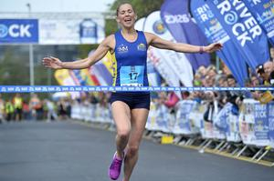 Press Eye - Belfast - Northern Ireland 1st May 2017 - Picture by Stephen Hamilton / Press Eye.  2017 Deep RiverRock Belfast City Marathon, Northern Ireland. Winner of the Ladys race Laura Graham pictured at the finish line at Ormeau park.