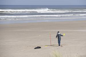 A man plays swing-ball on an almost deserted Castlerock Beach on Tuesday 24th March. Picture: Michael Cooper