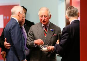 The Prince of Wales during a visit to the YMCA Londonderry at Drumahoe, in Londonderry, during a visit to communities hit by the summer's flash floods. Brian Lawless/PA Wire