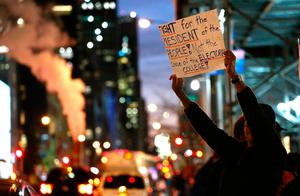 People take part in a protest against President-elect Donald Trump in front of Trump Tower in New York on November 10, 2016. / AFP PHOTO / KENA BETANCURKENA BETANCUR/AFP/Getty Images