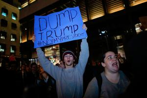A young man shouts slogans as he takes part in a protest against President-elect Donald Trump in front of Trump Tower in New York on November 10, 2016. / AFP PHOTO / KENA BETANCURKENA BETANCUR/AFP/Getty Images