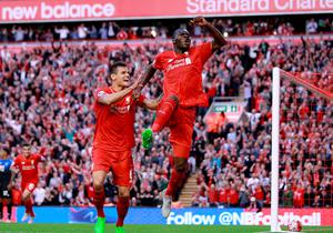 "Liverpool's Christian Benteke (right) celebrates scoring his side's first goal of the game during the Barclays Premier League match at Anfield, Liverpool. PRESS ASSOCIATION Photo. Picture date: Monday August 17, 2015. See PA story SOCCER Liverpool. Photo credit should read: Peter Byrne/PA Wire. EDITORIAL USE ONLY. No use with unauthorised audio, video, data, fixture lists, club/league logos or ""live"" services. Online in-match use limited to 45 images, no video emulation. No use in betting, games or single club/league/player publications."