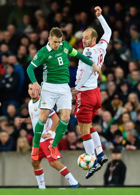 BELFAST, NORTHERN IRELAND - MARCH 24:  Steven Davis of Northern Ireland and Ivan Maevski of Belarus jump for the ball during the 2020 UEFA European Championships Group C qualifying match between Northern Ireland and Belarus at Windsor Park on March 24, 2019 in Belfast, United Kingdom. (Photo by Charles McQuillan/Getty Images)