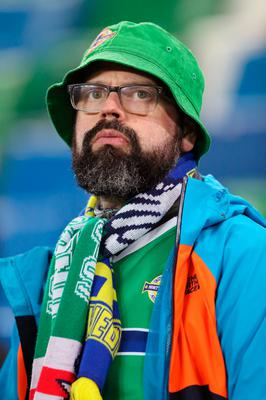 A Northern Ireland fan in the stands before the UEFA Euro 2020 Qualifying, Group C match at Windsor Park, Belfast. PRESS ASSOCIATION Photo. Picture date: Sunday March 24, 2019. See PA story SOCCER N Ireland. Photo credit should read: Brian Lawless/PA Wire. RESTRICTIONS: Use subject to restrictions. Editorial use only. No commercial use.
