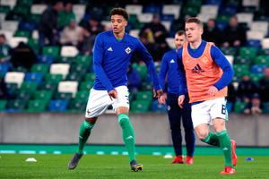 Northern Ireland's Jamal Lewis (left) and Steven Davis warm up before the UEFA Euro 2020 Qualifying, Group C match at Windsor Park, Belfast. PRESS ASSOCIATION Photo. Picture date: Sunday March 24, 2019. See PA story SOCCER N Ireland. Photo credit should read: Brian Lawless/PA Wire. RESTRICTIONS: Use subject to restrictions. Editorial use only. No commercial use.