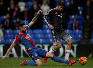 Crystal Palace's Irish defender Damien Delaney (L) clears the ball from the path of Chelsea's Brazilian-born Spanish striker Diego Costa during the English Premier League football match between Crystal Palace and Chelsea at Selhurst Park in south London on January 3, 2016. AFP PHOTO / ADRIAN DENNIS  RESTRICTED TO EDITORIAL USE. NO USE WITH UNAUTHORIZED AUDIO, VIDEO, DATA, FIXTURE LISTS, CLUB/LEAGUE LOGOS OR 'LIVE' SERVICES. ONLINE IN-MATCH USE LIMITED TO 75 IMAGES, NO VIDEO EMULATION. NO USE IN BETTING, GAMES OR SINGLE CLUB/LEAGUE/PLAYER PUBLICATIONS.ADRIAN DENNIS/AFP/Getty Images