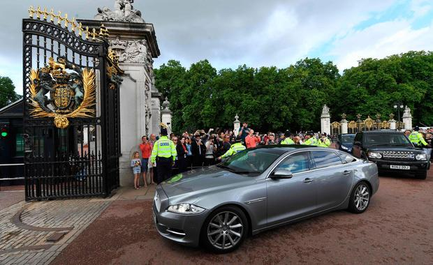 Theresa May arrives at Buckingham Palace to meet Queen Elizabeth. AFP/Getty Images