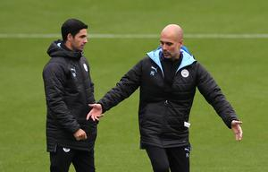 Mikel Arteta, left, worked with Pep Guardiola at Manchester City (Barrington Coombs/PA)