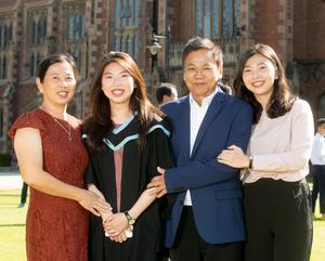 International student Dollee graduates with First Class Honours in Master of Pharmacy from the School of Pharmacy at Queen's University.  Dollee is pictured with her mum, dad and sister who have travelled from Malaysia and Singapore to celebrate her success.