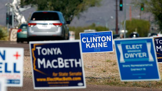 CAVE CREEK, AZ - NOVEMBER 08:  Motorists pass campaign signs in front of a polling station on November 8, 2016 in Cave Creek, Arizona. Throughout the country, millions of Americans are casting their votes today for either Hillary Clinton or Donald Trump to become the 45th president of the United States.  (Photo by Ralph Freso/Getty Images)
