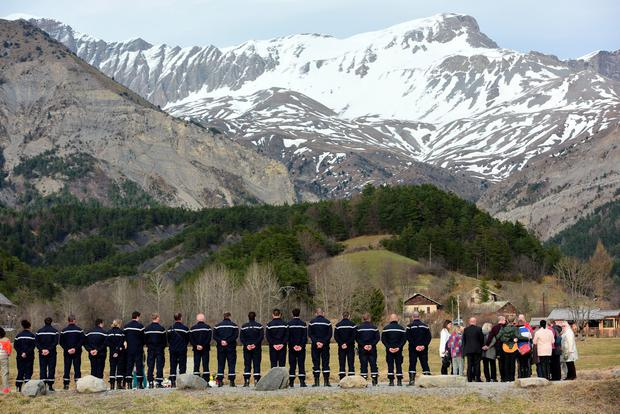 LA VERNET, FRANCE - MARCH 28:  Relatives stand at a monument to honour the victims of Germanwings flight 4U9525 in front of the mountains near the crash site on March 26, 2015 in Le Vernet, France. France.