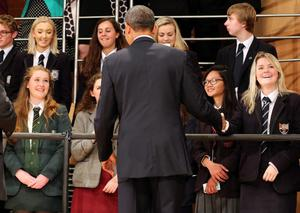 BELFAST, UNITED KINGDOM - JUNE 17:  U.S. President Barack Obama meets school children at the Waterfront Hall after delivering a keynote address ahead of the G8 Summit on June 17, 2013 in Belfast, Northern Ireland. Later The President will join other leaders at the G8 Summit in Fermanagh.  (Photo by Paul Faith - WPA Pool/Getty Images)