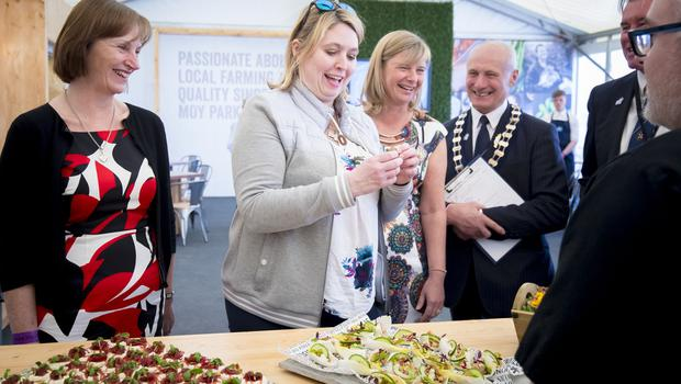 Karen Bradley samples food at the Moy Park stand on Day 2 of the Balmoral show on May 17th 2018 (Photo by Kevin Scott / Belfast Telegraph)