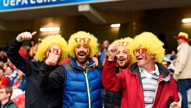 Belgium supporters cheer for their team before the Euro 2016 quarter-final football match between Wales and Belgium at the Pierre-Mauroy stadium in Villeneuve-d'Ascq near Lille, on July 1, 2016. / AFP PHOTO / MIGUEL MEDINAMIGUEL MEDINA/AFP/Getty Images