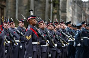 Troops form up outside St Giles' Cathedral, Edinburgh, during a Remembrance Sunday parade held in tribute for members of the armed forces who have died in major conflicts. Danny Lawson/PA Wire.
