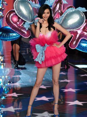 NEW YORK, NY - NOVEMBER 10:  Model Ming Xi from China walks the runway during the 2015 Victoria's Secret Fashion Show at Lexington Avenue Armory on November 10, 2015 in New York City.  (Photo by Dimitrios Kambouris/Getty Images for Victoria's Secret)