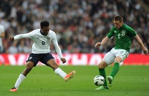 LONDON, ENGLAND - MAY 29:  Daniel Sturridge of England takes on James McCarthy of the Republic of Ireland during the International Friendly match between England and the Republic of Ireland at Wembley Stadium on May 29, 2013 in London, England.  (Photo by Shaun Botterill/Getty Images)