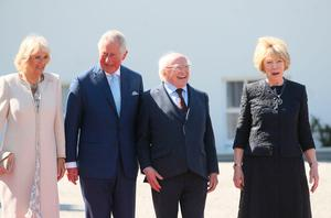 The Prince of Wales and Duchess of Cornwall is welcomed by Irish President Michael D Higgins and wife Sabina Coyne to Aras an Uachtarain in Dublin, during their visit to the Republic of Ireland. PRESS ASSOCIATION Photo. Picture date: Wednesday May 10, 2017. See PA story ROYAL Ireland. Photo credit should read: Brian Lawless/PA Wire