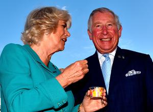DROMORE, NORTHERN IRELAND - MAY 10: Camilla, Duchess of Cornwall and Prince Charles, Prince of Wales laugh as they share an ice cream during their visit to the village market on May 10, 2017 in Dromore, Northern Ireland. Their Royal Highnesses are on the second day of their visit to the province. (Photo by Charles McQuillan/Getty Images)