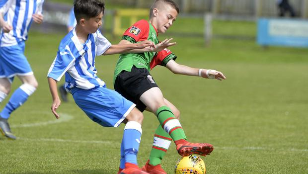 1st August 2019  Statsports Supercup NI 2019  Minor section semi final  match between Glentoran and Finn Harps at Seahaven in Portstewart. Glentorans Reece Lyttle in action with Finn Harps Luca Barrett Mandatory Credit : Stephen  Hamilton/Presseye