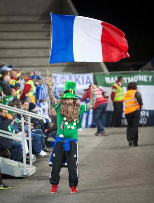 A Northern Ireland fan waves the French flag during the UEFA European Championship Qualifying match at Windsor Park, Belfast. PRESS ASSOCIATION Photo. Picture date: Thursday October 8, 2015. See PA story SOCCER N Ireland. Photo credit should read: Liam McBurney/PA Wire.