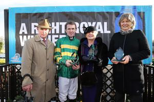 Northern Ireland Festival of Racing at Down Royal Racecourse - Day 1  Race 4 (2:35) WKD Hurdle  Winning jockey Tony McCoy, winning trainer Jessica Harrington and owner Frank Berry receives the winning trophies from Mrs Sloan from sponsors WKD.  Picture by Kelvin Boyes / Press Eye.